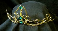 GOLD CIRCLET WITH GREEN STONES